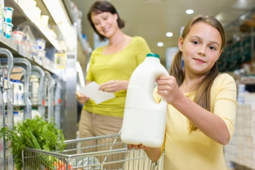 Girl Holding Gallon of Milk