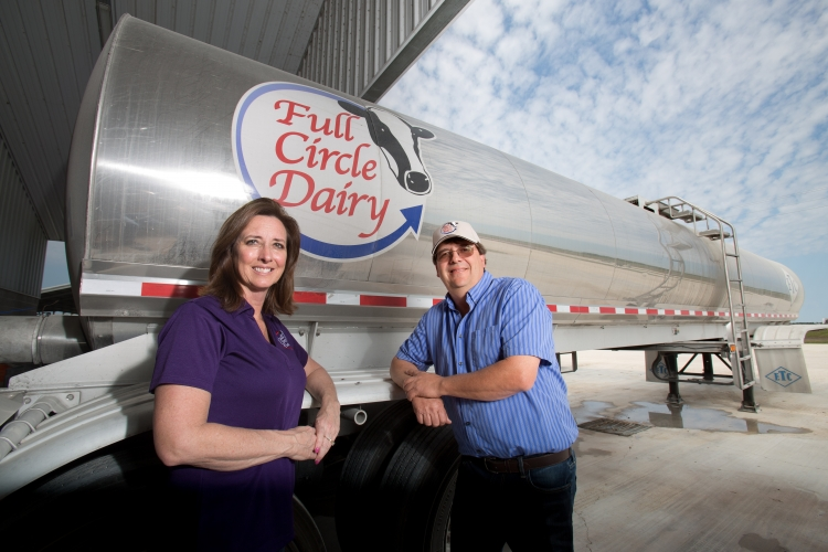 dairy farmer greg watts stands in front of milking truck