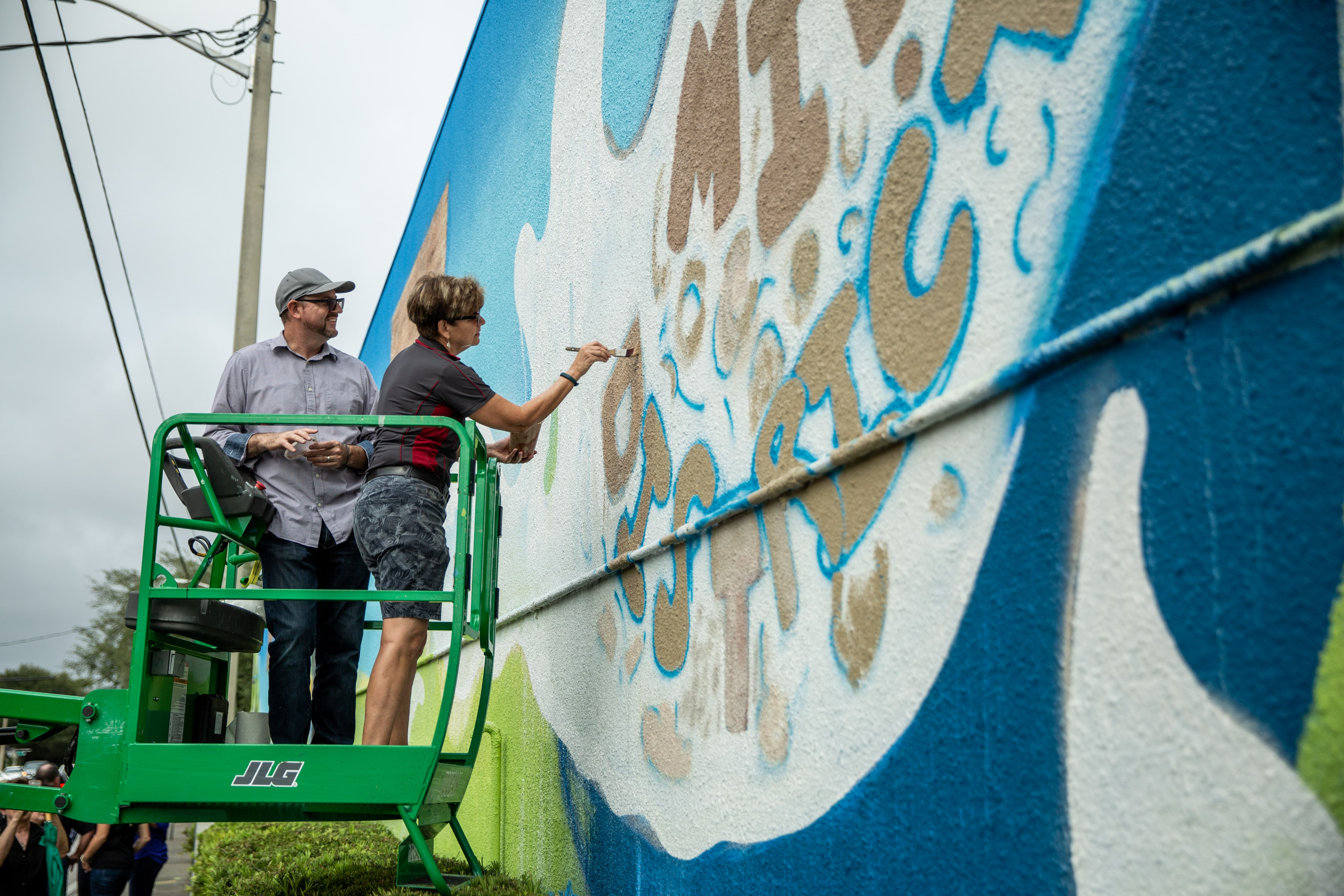 Public official working on mural