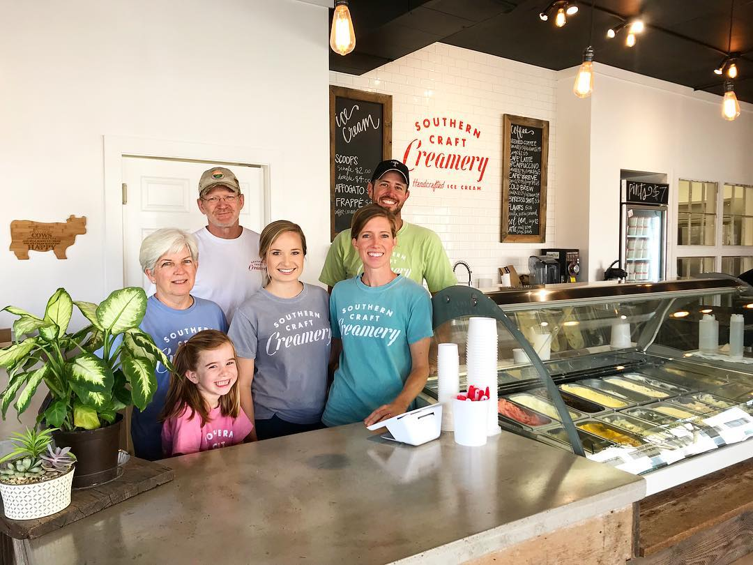 Eade family standing together in their ice cream shop